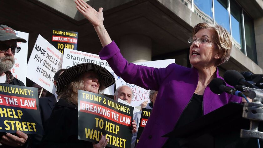 Sen. Elizabeth Warren (D-Mass.) speaks during a protest in front of the Consumer Financial Protection Bureau headquarters on Tuesday.