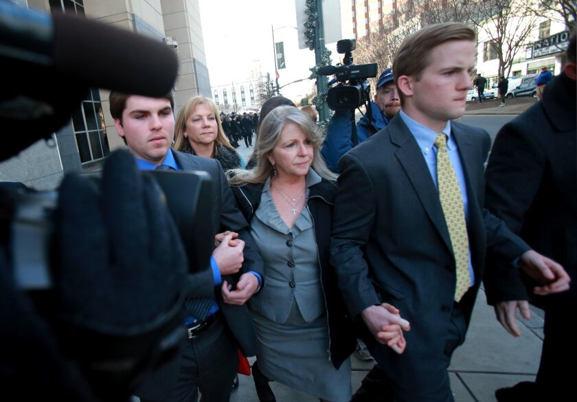 Former Virginia first lady Maureen McDonnell, center, leaves federal court with her sons, Bobby, left, and Sean after her husband, former Gov. Bob McDonnell, was sentenced to two years in federal prison for corruption charges, Tuesday, January 6, 2015, in Richmond, Va.