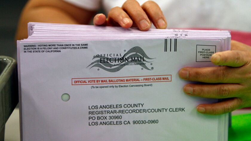 A clerk sorts vote by mail ballots in at the Los Angeles County Registrar's office in Norwalk in Nov. 2010.