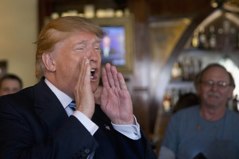 Republican presidential candidate Donald Trump gestures as he speaks during a lunch stop, Thursday, Feb. 18, 2016, in North Charleston, S.C. (AP Photo/Matt Rourke)