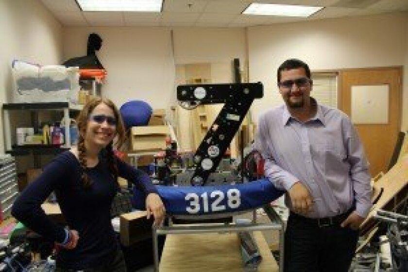 Canyon Crest Academy sophomore Maya Ziu and alumni robotics team mentor Tyler Carter will be part of a new robotics camp at the school this summer. Photo by Karen Billing