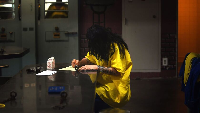 LOS ANGELES, CA-OCTOBER 2, 2017: An inmate sits alone at Century Regional Detention Facility in Los
