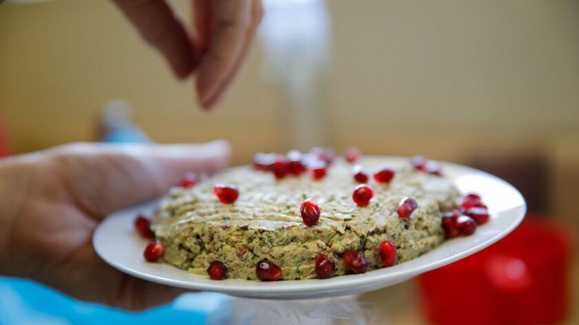 GLENDALE, CALIF. -- SUNDAY, JULY 22, 2018: Elmira avetian prepares pkhali, a Georgian appetizer with