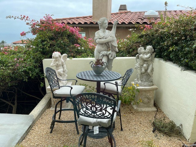 Statues of mythical figures create vignettes at the La Jolla home of artist Dottie Stanley.