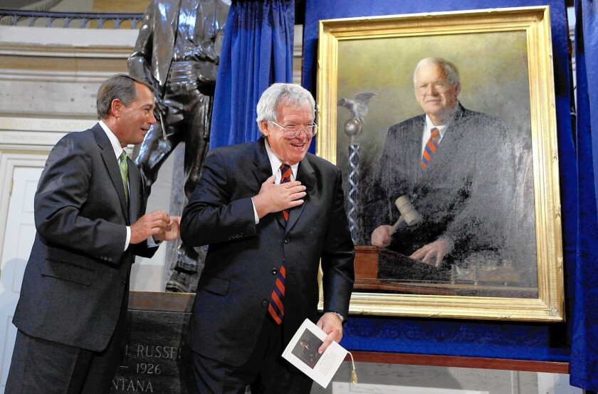 Dennis Hastert and his portrait during the painting's official unveiling at the U.S. Capitol on July 28, 2009, in Washington, D.C.
