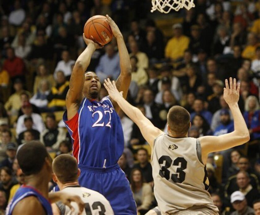 Kansas forward Markieff Morris shoots over Colorado's Austin Dufault, right, during the first half of an NCAA college basketball game in Boulder, Colo., on Wednesday, Feb. 3, 2010. (AP Photo/Ed Andrieski)
