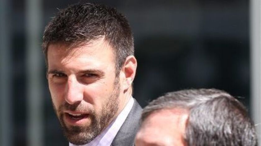 Texans linebacker coach Mike Vrabel, pictured in 2011, will interview with the Rams this week for their vacant head-coaching position.