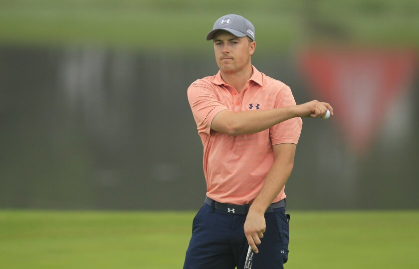 Jordan Spieth of the United States reacts on the 2nd hole during the third round of the HSBC Champions golf tournament at the Sheshan International Golf Club in Shanghai, China Saturday, Nov. 7, 2015. (AP Photo)