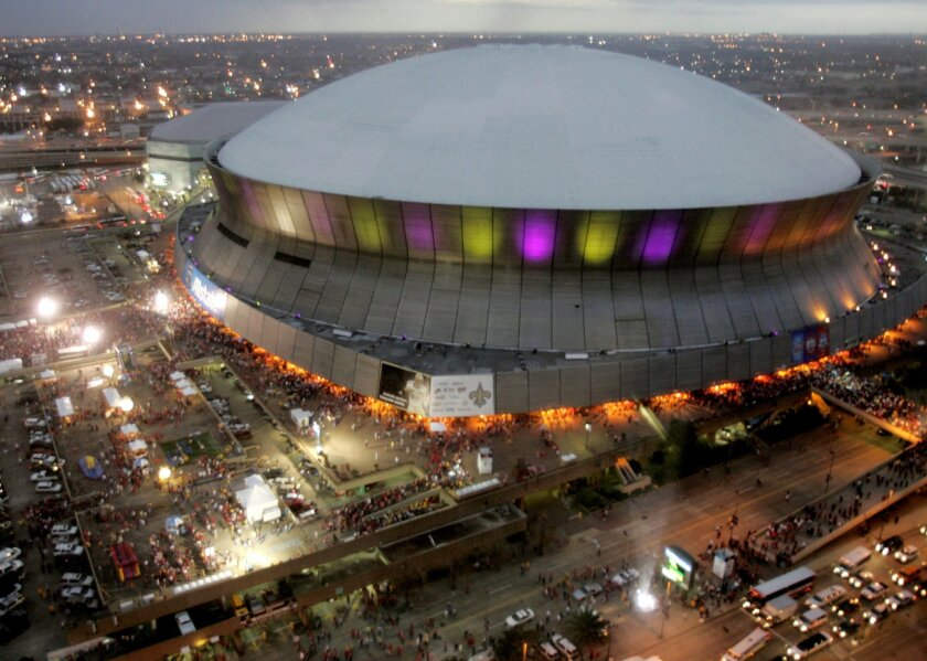 FILE - In this Jan. 7, 2008, file photo, color lights play on the Superdome at twilight before the BCS championship college football game between LSU and Ohio State in New Orleans. Atlanta, New Orleans and Santa Clara, California, have been selected to host College Football Playoff national champio