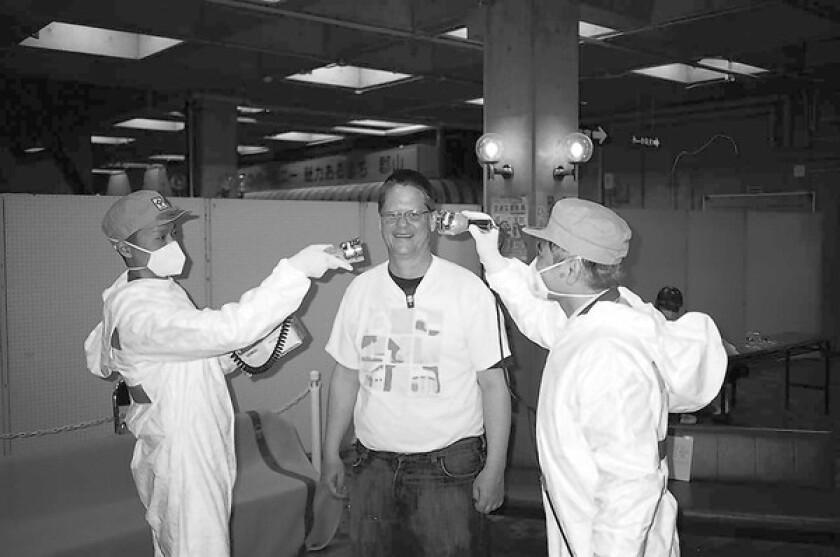 William T. Vollmann undergoes radiation screening in Japan.