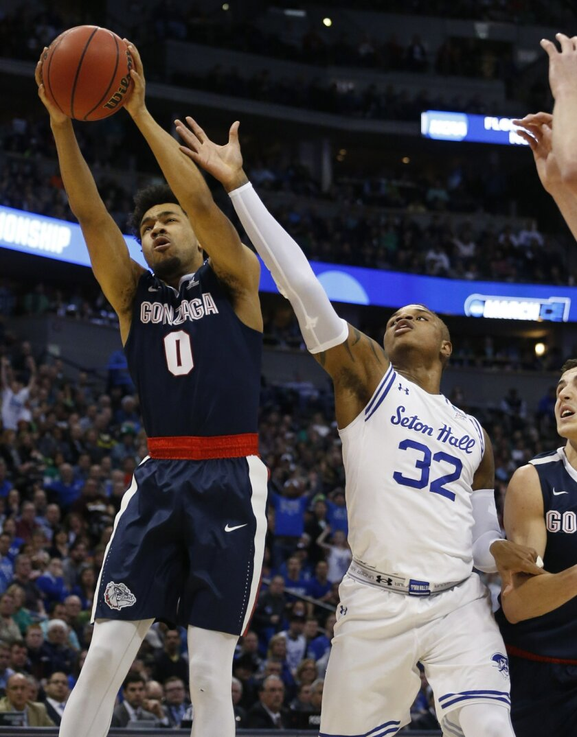 Gonzaga guard Silas Melson, left, pulls in a rebound as Seton Hall guard Derrick Gordon reaches for it during the first half of a first-round game Thursday, March 17, 2016, in the NCAA men's college basketball tournament in Denver.  (AP Photo/Brennan Linsley)