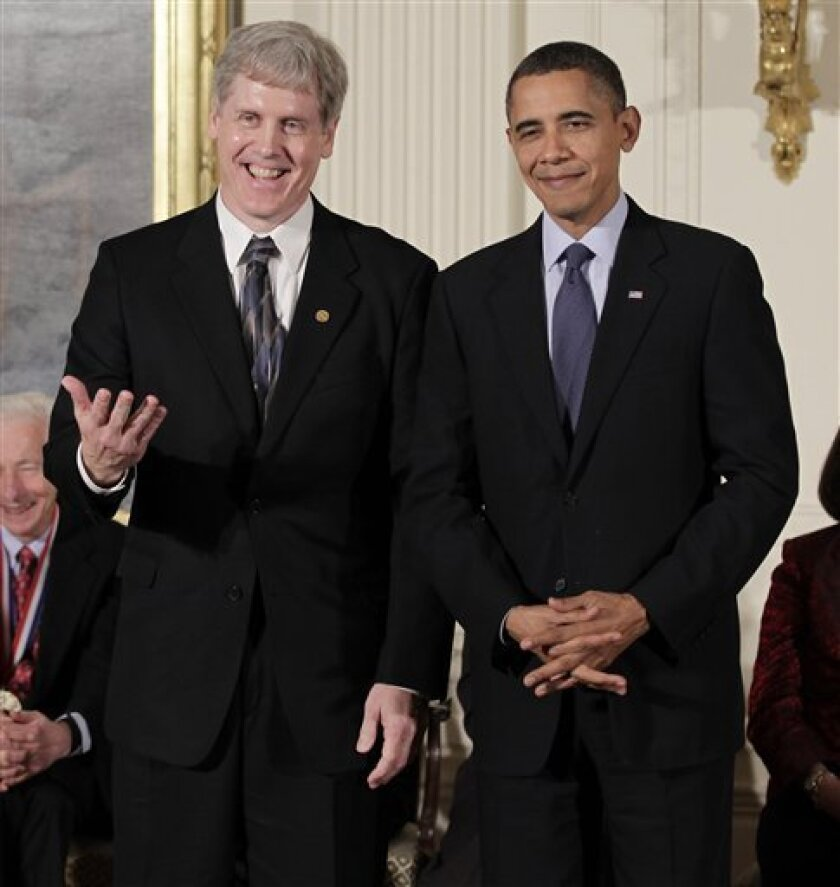 President Barack Obama laughs with Steven J. Sasson, left, who invented the digital camera at Eastman Kodak, during a ceremony for recipients of the National Medal of Science and the National Medal of Technology and Innovation, the highest honors bestowed by the United States government on scientis