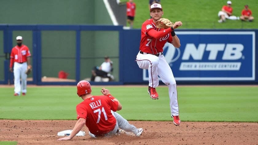 Nationals shortstop Trea Turner (7) turns a double play after forcing out St. Louis Cardinals catcher Carson Kelly (71) at The Ballpark of the Palm Beaches on March 3, 2017.
