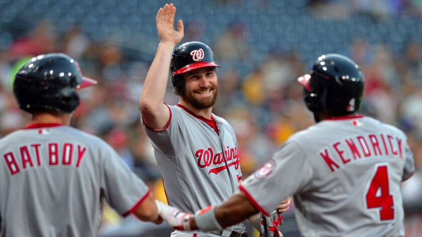 Washington Nationals left fielder Howie Kendrick (right) celebrates with second baseman Daniel Murphy (center) after hitting a solo home run during the first inning at Petco Park.