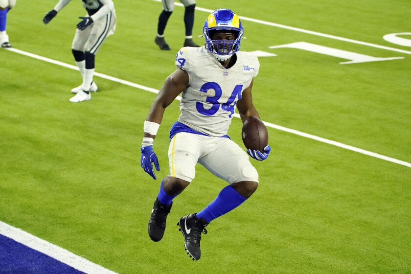Los Angeles Rams running back Malcolm Brown leaps into the end zone for a touchdown during the second half of an NFL football game against the Dallas Cowboys Sunday, Sept. 13, 2020, in Inglewood, Calif. (AP Photo/Ashley Landis)