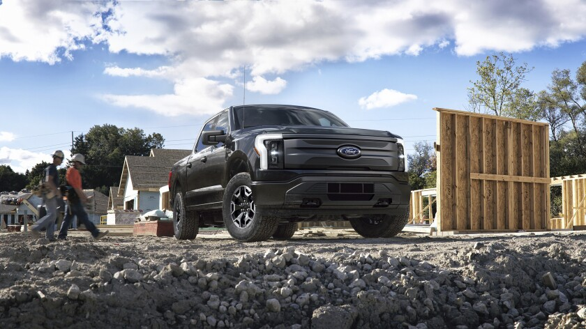 This photo provided by Ford Motor Co., shows the upcoming 2022 Ford F-150 Lightning, that is part of a new generation of emerging electric vehicles. Ford Motor Co. via AP)