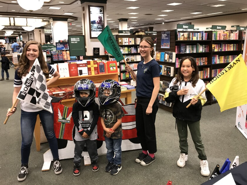 Athena Racing team members Adeline Slocum, left, and Izzy Wright, second from right, appeared at a program at Barnes & Noble in La Mesa recently. They're with children who stopped by to talk with them about STEM careers in the transportation, automotive and motorsports sectors.