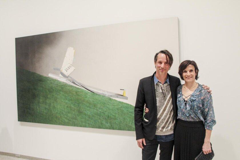 Eddie Ruscha, son of the artist, with his wife, Francesca Gabbiani, and 'Psycho Spaghetti Western #3'