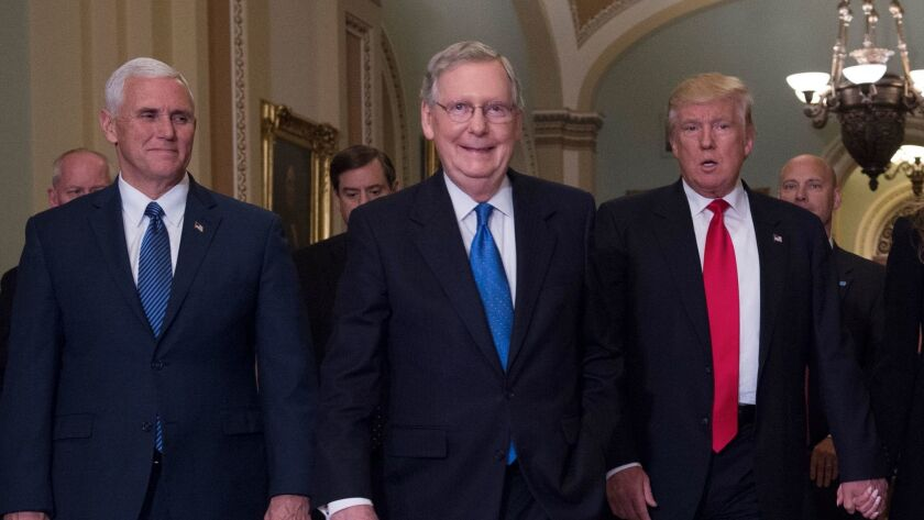 Senate Majority Leader Mitch McConnell, R-Ky., is flanked by Vice President-elect Mike Pence and President-elect Donald Trump on a Capitol tour Thursday.
