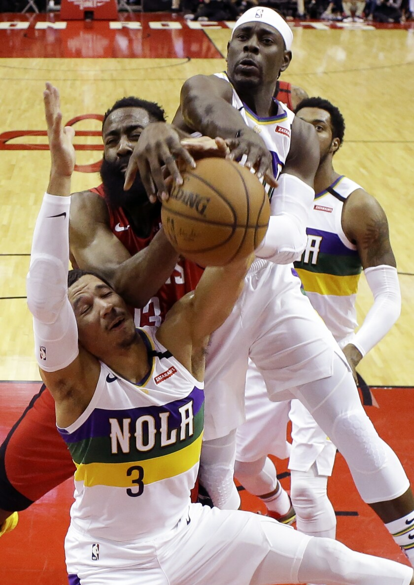 New Orleans Pelicans guards Josh Hart (3) and Jrue Holiday, top, vie with Houston Rockets guard James Harden, center, for a rebound during the first half of an NBA basketball game, Sunday, Feb. 2, 2020, in Houston. (AP Photo/Eric Christian Smith)