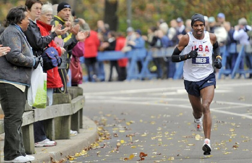 New York City Marathon spectators in Central Park cheered on Meb Keflezighi yesterday on his way to becoming the first American to win the race since 1982.