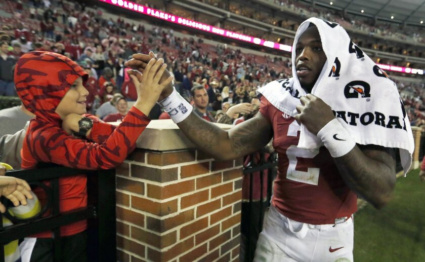 Alabama running back Derrick Henry (2) greets fans after they defeated Charleston Southern 56-6 in an NCAA football game, Saturday, Nov. 21, 2015, in Tuscaloosa, Ala. (AP Photo/Butch Dill)