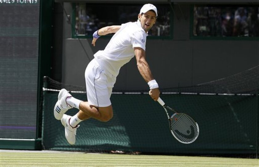 Serbia's Novak Djokovic in action during the match against South Africa's Kevin Anderson at the All England Lawn Tennis Championships at Wimbledon, Thursday, June 23, 2011. (AP Photo/Kirsty Wigglesworth)