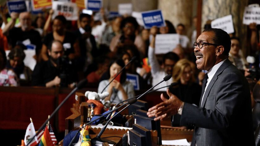 L.A.. City Council President Herb Wesson, gives an impassioned sppech, often interrupted by yelled a