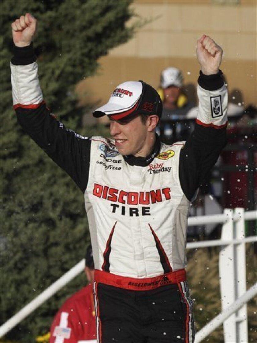 Driver Brad Keselowski celebrates in victory lane after winning the NASCAR Nationwide auto race at Kansas Speedway in Kansas City, Kan., Saturday, Oct. 8, 2011. (AP Photo/Orlin Wagner)