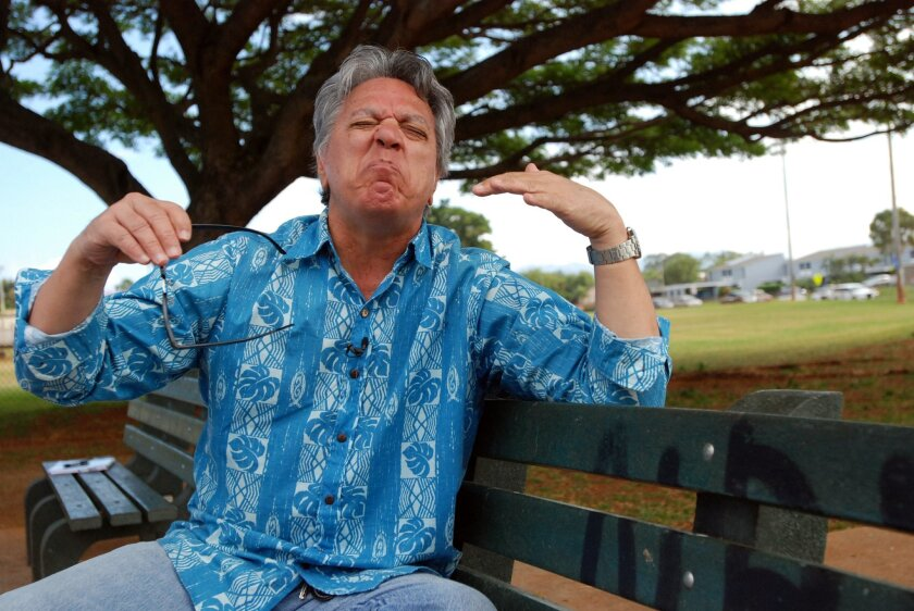 In this Jan. 28, 2016 photo, comedian Andy Bumatai gestures during an interview in Mililani, Hawaii. News reports on census data showing the number of Pidgin speakers in Hawaii have helped spark a sense of pride among those who speak the language in their homes. (AP Photo/Audrey McAvoy)