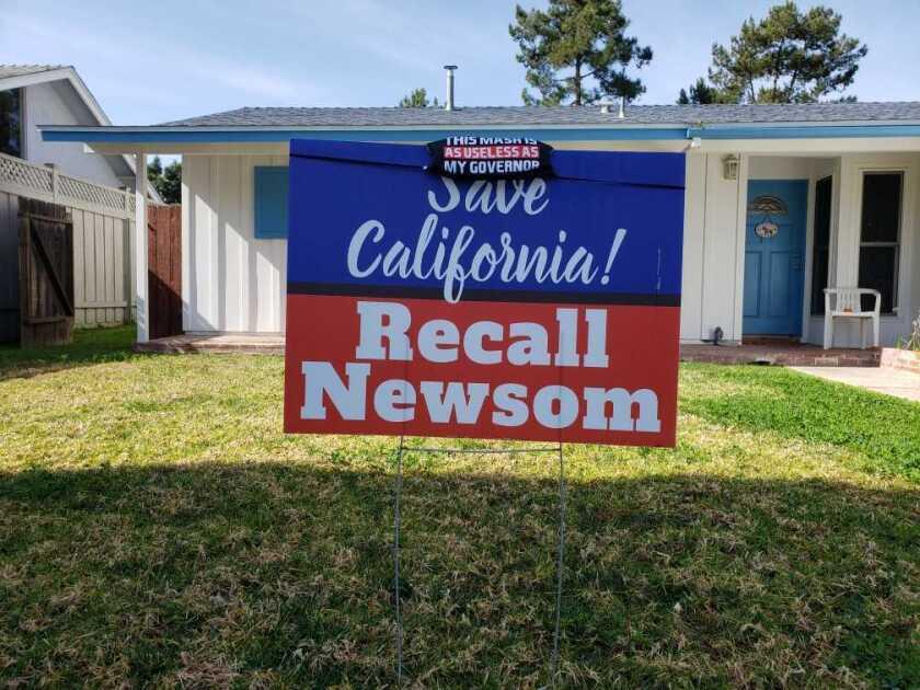 A sign to recall California Gov. Gavin Newsom in San Diego.