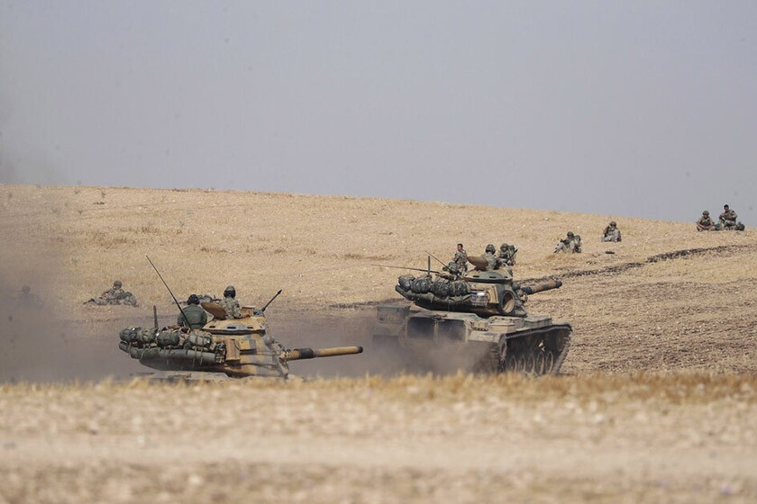 Turkish tanks and troops approach the Syrian town of Manbij on Tuesday.