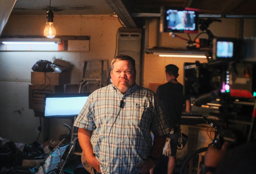 """A photograph of John Nolan on the set of """"The Paper Tigers,"""" a kung fu action-comedy feature film."""
