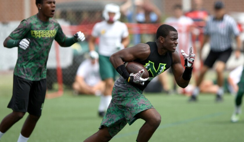 Narbonne defender Lawson Hall returns an interception during a passing tournament.