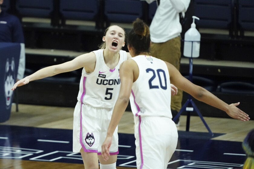 Connecticut guard Paige Bueckers (5) reacts after her three-point basket against South Carolina in overtime of an NCAA college basketball game in Storrs, Conn., Monday, Feb. 8, 2021. (David Butler/Pool Photo via AP)