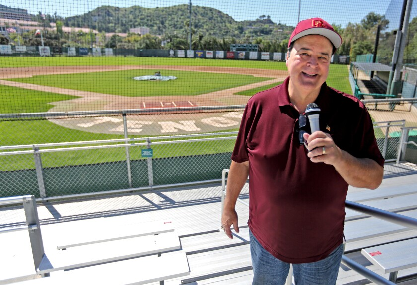 Area sports announcer Spiro Psaltis poses with a microphone at an empty Stengel Field in Glendale on Thursday, April 16, 2020.