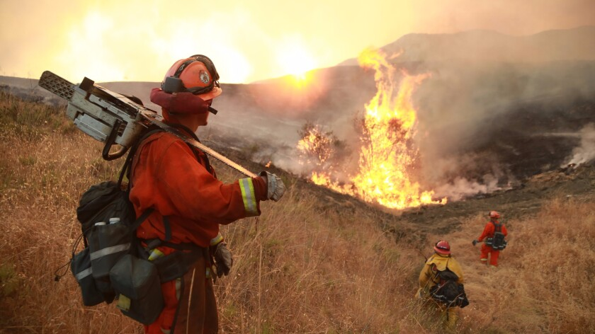 Firefighters in Santa Clarita battled the Sand fire in July amid sweltering temperatures and heavy winds.