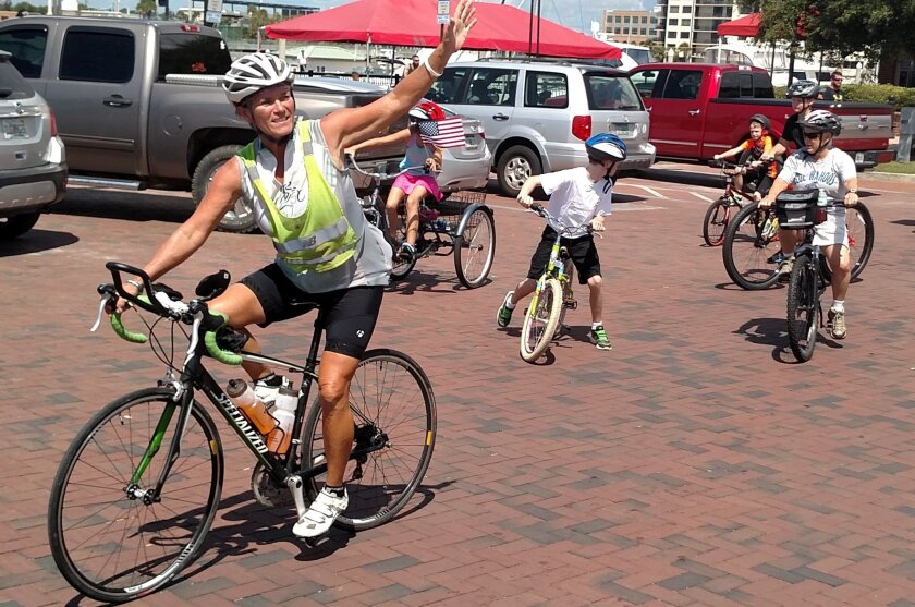 After two months of cycling from Ocean Beach 50 miles a day for worthy causes, Diane Lea arrived in Pensacola, Fla. Aug. 20. Liz Watkins, who took this photo, accompanied Lea throughout her 2,500-mile road trip in a trailer documenting her experiences.
