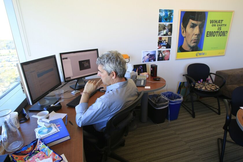 Uri Gneezy, who is the Epstein/Atkinson chair in Behavioral Economics at UCSD, works in his office on Wednesday at the Rady School of Management