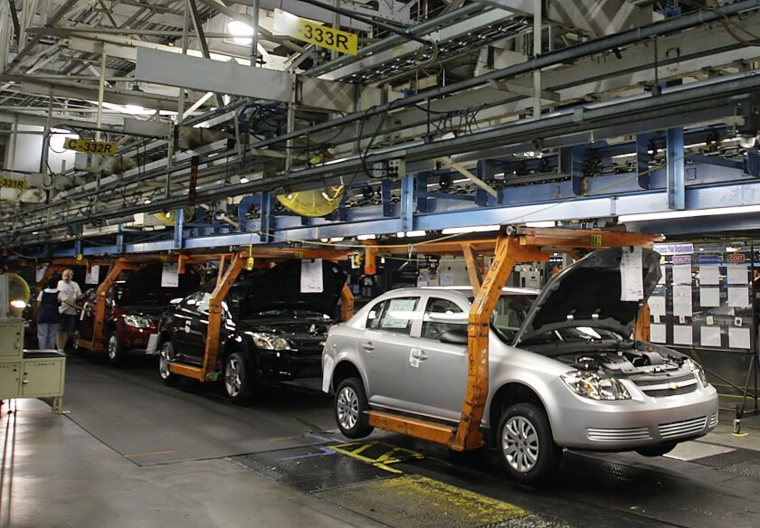 A Chevy Cobalt moves on the assembly line at the Lordstown Assembly Plant in Ohio in 2014. General Motors no longer owns the plant, but President Trump thinks the company should reopen it to make ventilators.