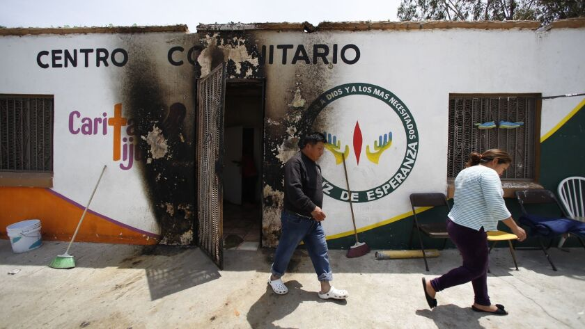 Migrants at Caritas Tijuana, a small Catholic-run shelter, awoke to a burning mattress put outside their door early Monday.