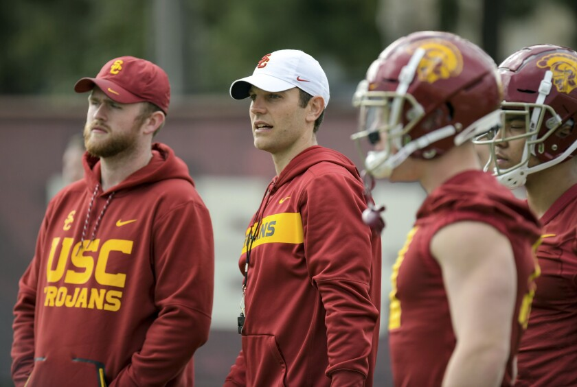 USC offensive coordinator Graham Harrell, center, watches the Trojans work out during a spring practice.