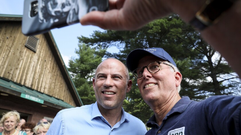 Michael Avenatti, left, poses for a selfie with Mike Munhall of Bennington after speaking at the Hillsborough County Democrats' Summer Picnic fundraiser in Greenfield, N.H., on Sunday.