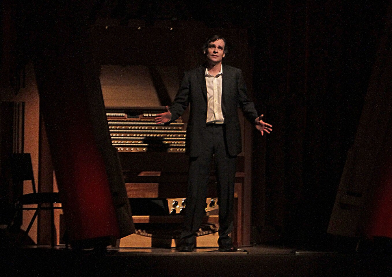 """Robert Sean Leonard performing a scene from """"Hamlet."""" Gustavo Dudamel conducted the Simon Bolivar Symphony Orchestra of Venezuela in Tchaikovsky's overtures of Shakespearean themes at Walt Disney Concert Hall on Wednesday."""