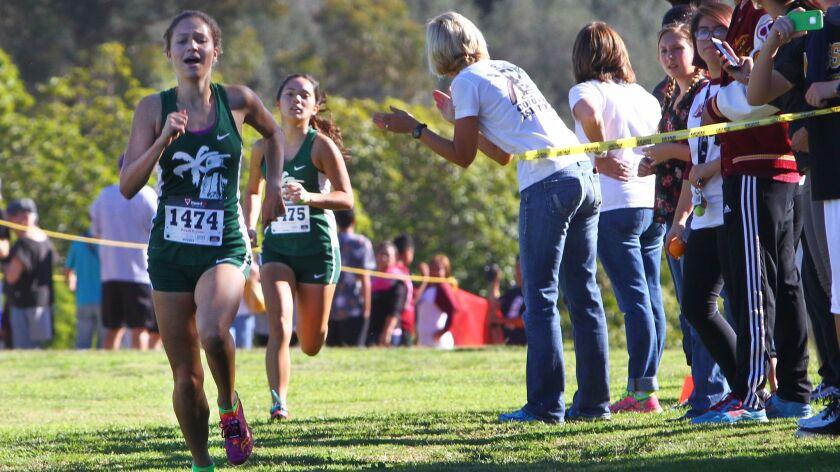 Coronado senior runner Renee Phillips leads the pack on the Morley Field course in Balboa Park.