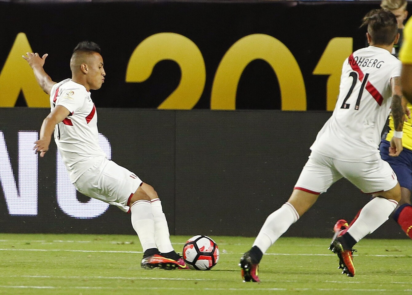 Peru's Christian Cueva, left, kicks the ball for a goal as teammate Alejandro Hohberg (21) watches during the first half of a Copa America group C soccer match against Ecuador on Wednesday, June 8, 2016, in Glendale, Ariz. (AP Photo/Ross D. Franklin)