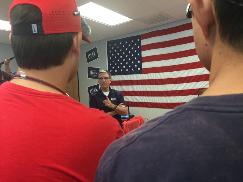 Republican Joe Heck talks with campaign volunteers in Nevada.