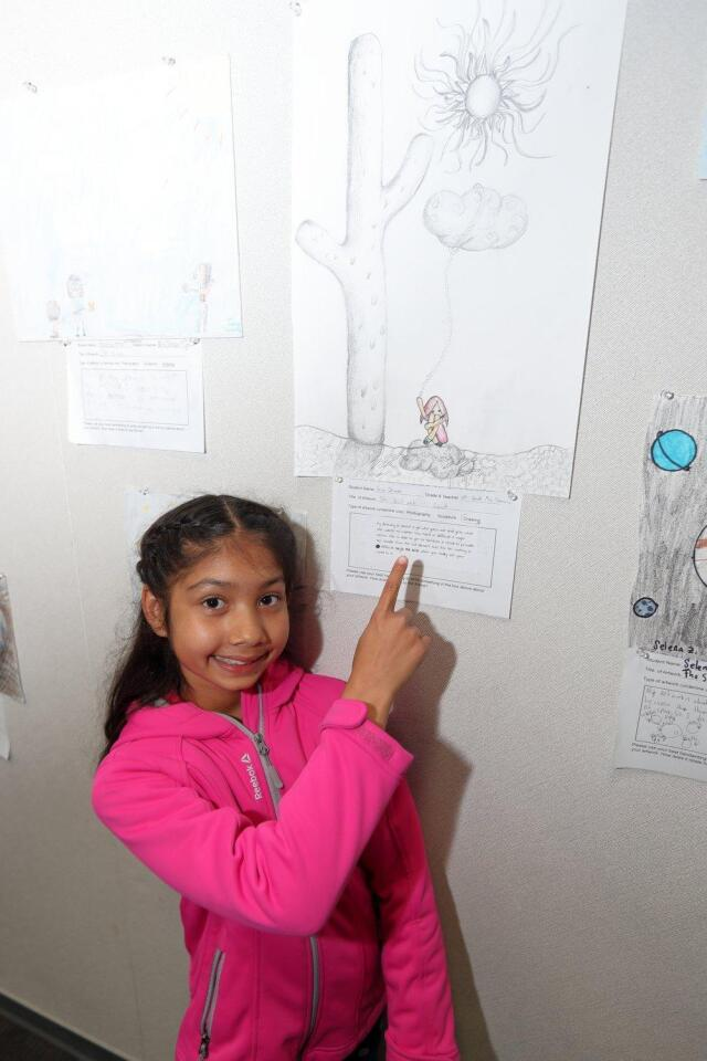 """Viaia Dhiman with her drawing """"The Girl and Her Cloud"""""""