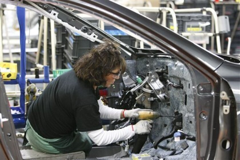 In this Feb. 18, 2010 photo, Toyota employee Linda Patrick installs an accelerator into a new Camry in Georgetown, Ky. Toyota said Tuesday, March 2, its U.S. sales fell 9 percent in February, reflecting the fallout from widespread recalls and a temporary sales halt.(AP Photo/Ed Reinke)