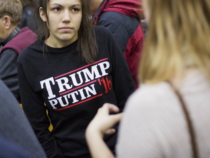 """A woman wears a shirt reading """"Trump Putin '16"""" while waiting for Republican presidential candidate Donald Trump at an event earlier this year in Plymouth, N.H."""